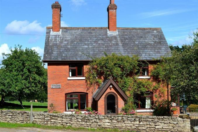 Click here for more about Acres Down Farm Cottage